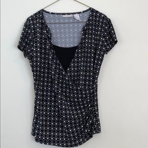Blouse with rushed sides and built in black insert